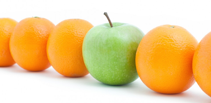 image showing an apple and several oranges in a line